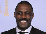 A smiling Idris Elba, who was recognised for his role in Luther