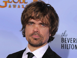 "Actor Peter Dinklage poses backstage with the award for Best Supporting Actor in a Series, Mini Series or TV Movie for ""Game of Thrones"""