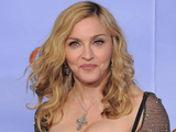 Madonna shows off her award and her dress simultaneously