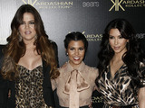 Khloe Kardashian, left, Kourtney Kardashian, center, and Kim Kardashian