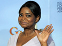 The Help's Octavia Spencer - winner of 'Best Supporting Actress In A Motion Picture' - waves to photographers
