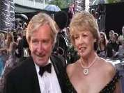 Bill Roache and his wife being interviewed on the red carpet at the 2007 British Soap Awards in London.