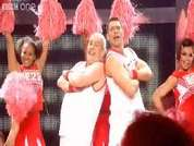 EastEnders actors Cliff Parisi and John Partridge - Minty and Christian in the soap - dance to High School Musical's 'We're All In This Together' in aid of Comic Relief 2009.