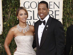 Beyonce, left, is joined by husband Jay-Z, as she arrives at the 66th Annual Golden Globe Awards on Sunday, Jan. 11, 2009, in Beverly Hills