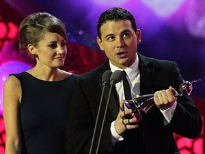 Ryan Thomas and Paula Lane collect the Serial Drama Performance on behalf of Katherine Kelly during the 2012 NTA Awards