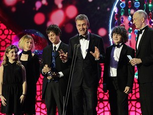 Hugh Dennis accepts the Situation Comedy award for Outnumbered on stage during the 2012 NTA Awards
