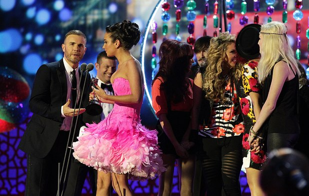 Gary Barlow and Tulisa Contostavlos collect the Best Talent Show award for X Factor on stage during the 2012 NTA Awards