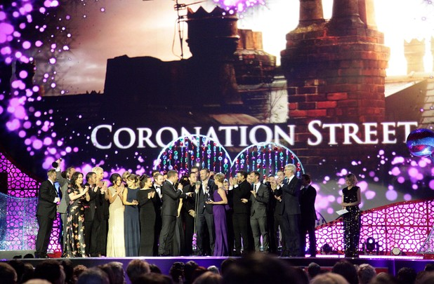 Cast and crew of Coronation Street collect the Serial Drama award on stage during the 2012 NTA Awards
