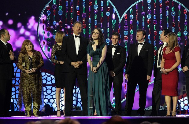 Cast and crew of Downton Abbey collect the Best Drama award on stage during the 2012 NTA Awards