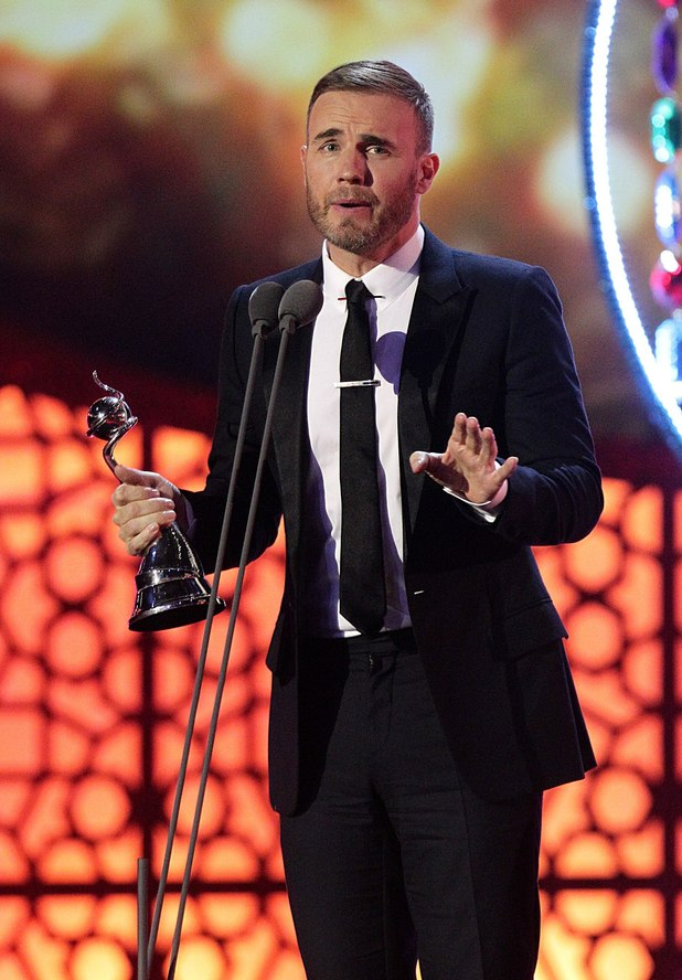 Gary Barlow collects the award for Outstanding Contribution during the 2012 NTA Awards