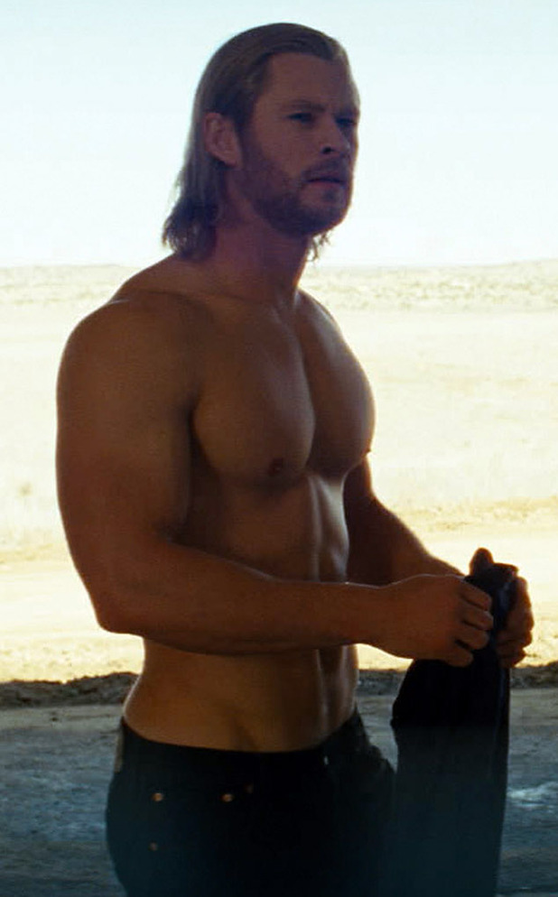 Chris Hemsworth on the beach