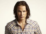 Taylor Kitsch as Tim Riggins in Friday Night Lights