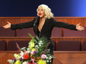Christina Aguilera earns a standing ovation from mourners as she sings 'At Last'.