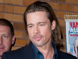 "Brad Pitt greeting his fans outside ""The Daily Show"" studios in Manhattan New York City"