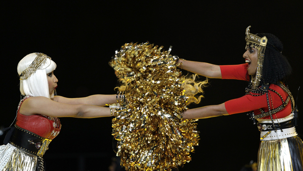 Nicki Minaj, left, and M.I.A performs during halftime of the NFL Super Bowl XLVI