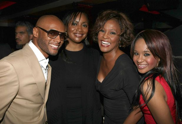 Whitney Houston with Kenny Lattimore, Patricia Houston, and daughter Bobbi Kristina, 2 days before her death