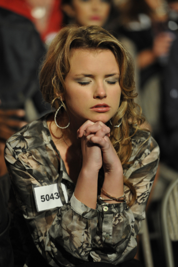 A Contestant praying