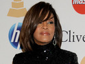 A Hilton Hotel security member reports Whitney Houston's body to authorities.