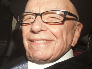 Rupert Murdoch, head of News Corp leaving his Mayfair home in a car.