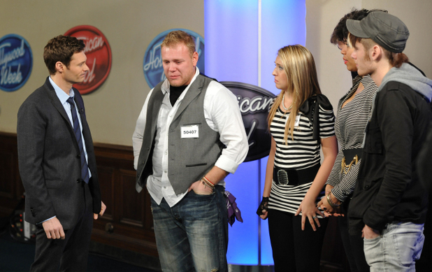 Ryan Seacrest with contestants in American Idol Hollywood Week