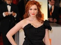 "Christina Hendricks says her Mad Men character is much ""ballsier"" than she is."