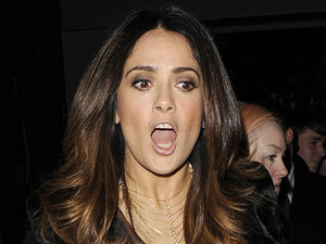 Salma Hayek gets her shoe stuck in a metal grid and nearly falls in London