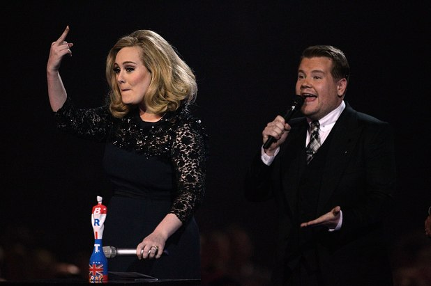 Adele sticks her middle finger up after being cut off at the Brits 2012