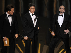 "Alexander Payne, Nat Faxon and Jim Rash accept the Oscar for best adapted screenplay for '""The Descendants'"" during the 84th Academy Awards"