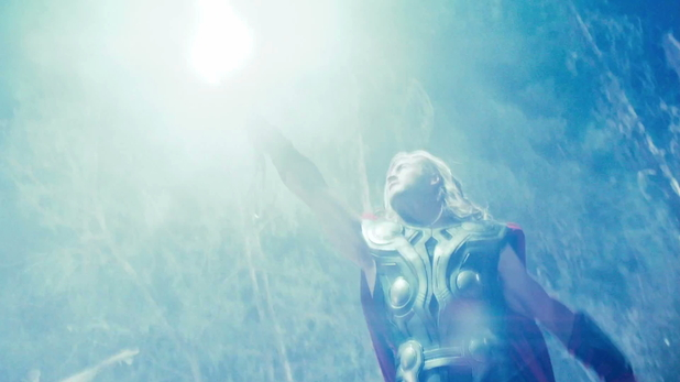 Thor (Chris Hemsworth) lifts the hammer to the sky...