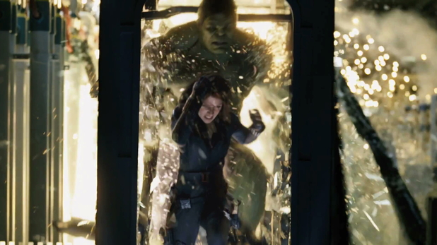 Black Widow runs away from the Hulk.