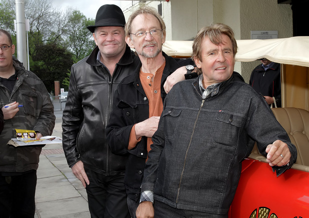 Peter Tork, Mickey Dolenz and Davy Jones of The Monkees at a photocall with the Monkeymobile