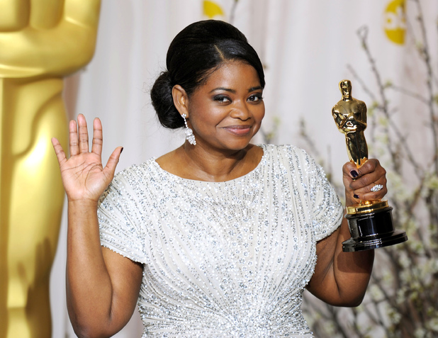Octavia Spencer with her Best Supporting Actress Oscar at the 84th Academy Awards ceremony