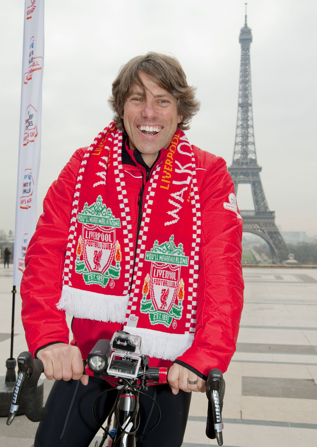 John wearing a Liverpool scarf