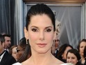 Sandra Bullock is suing a watch company for using her name and likeness.