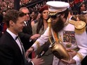 Ryan Seacrest responds to Sacha Baron Cohen spilling ashes over him at the Oscars.