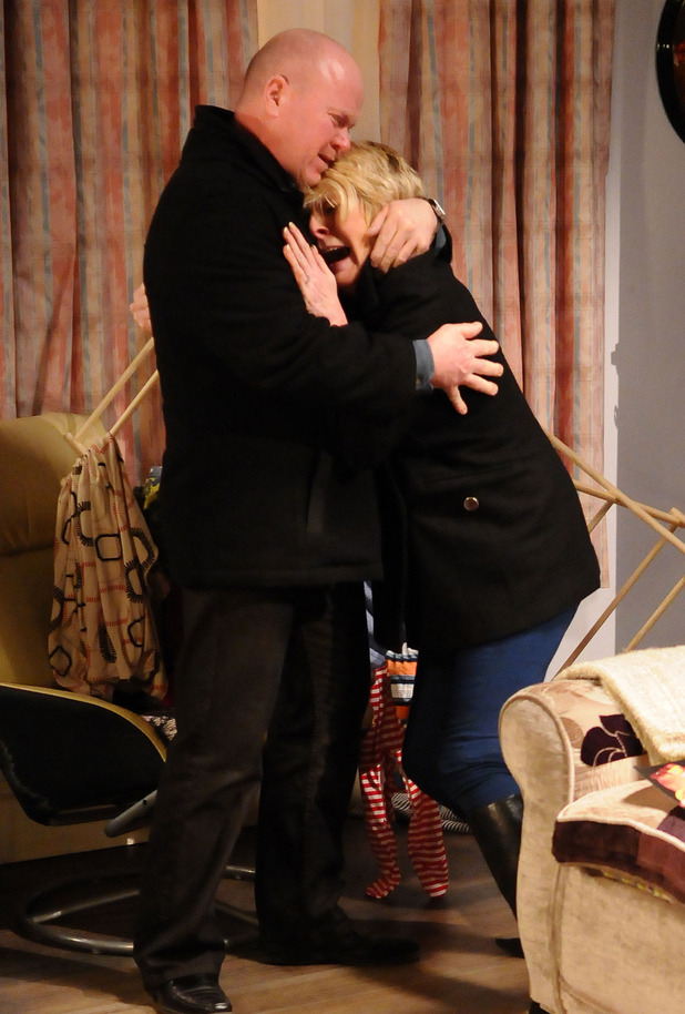 Phil Mitchell (Steve McFadden) comforts Shirley Carter (Linda Henry) over Heather's death
