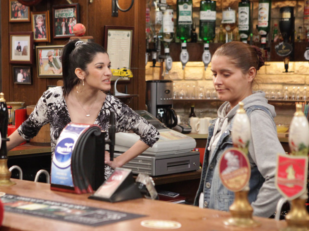 Alicia and Rachel argue behind the bar, both insisting they do not fancy David