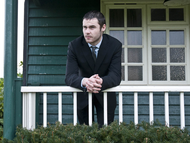 Aaron waits at the cricket pavilion in his suit, as he thinks about the day ahead and his impending court case
