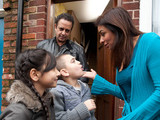 Sunita says goodbye to Dev and the kids as they leave for their holiday without her