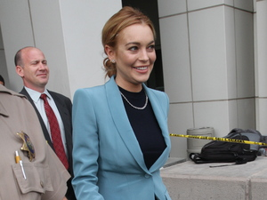 Lindsay Lohan appears in good spirits as she leaves LAX Courthouse with an escort from the Los Angeles County Sheriff Department Los Angeles