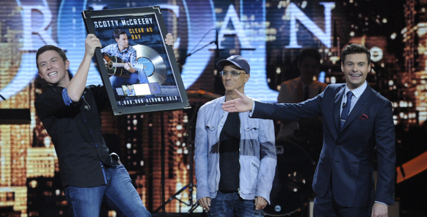 Scotty McCreary is presented with a platinum record for 'Clear As Day'
