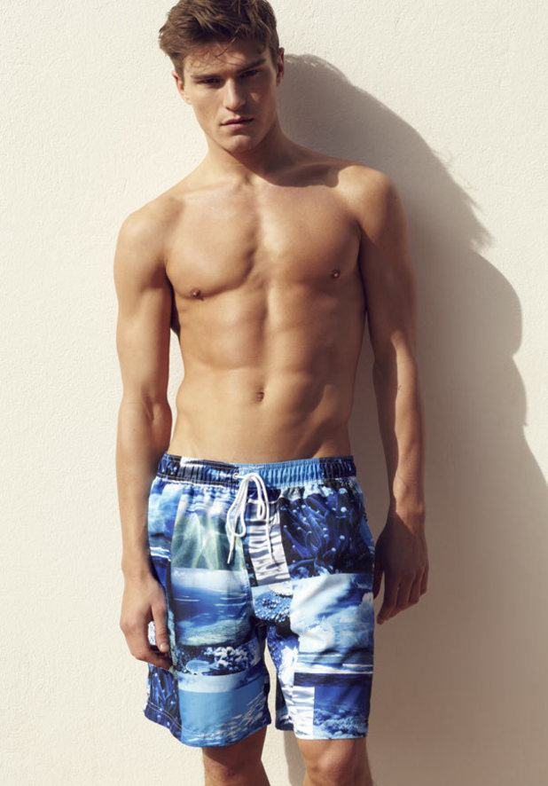 Oliver works it in a jazzy, seaside print trunk