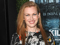 Mireille Enos says that she had to kiss Brad Pitt on the second day of shooting.