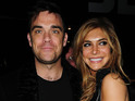 Robbie Williams posts a picture of wife Ayda's baby bump on his website.