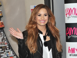 Demi Lovato signs copies of her new album 'Unbroken' at HMV Oxford Circus. London