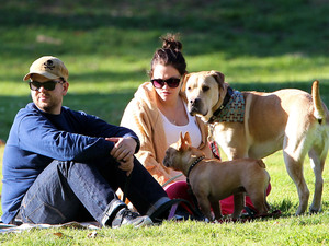 Jack Osbourne and his pregnant fiancee Lisa Stelly chill out on a blanket in the park with their dogs Los Angeles, California