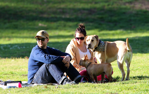 Jack Osbourne and his pregnant fiancee Lisa Stelly chill out on a blanket in the park with their dogs