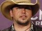 "Jason Aldean, wife ""fine"" after scandal"