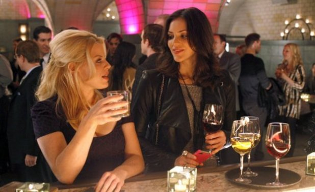 Megan Hilty as Ivy Lynn, Katharine McPhee as Karen Cartwright 