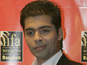 Karan Johar says that Bollywood is now welcoming to outsiders.